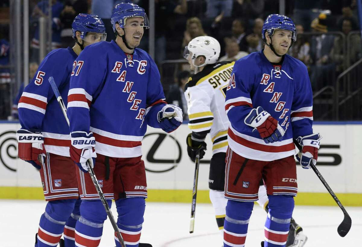 New York Rangers defenseman Ryan McDonagh (27) celebrates after scoring a goal against the Boston Bruins during the second period of an NHL preseason hockey game at Madison Square Garden in New York, Wednesday, Sept. 30, 2015. (AP Photo/Adam Hunger)