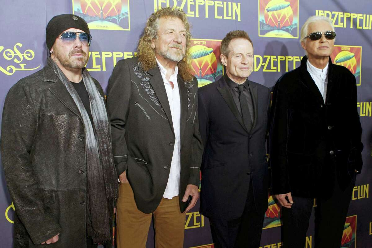 """This Oct. 9, 2012, file photo shows, from left, Jason Bonham, son of the late Led Zeppelin drummer John Bonham; singer Robert Plant; bassist John Paul Jones; and guitarist Jimmy Page at the """"Led Zeppelin: Celebration Day"""" premiere in New York. Generations of aspiring guitarists have tried to copy the riff from Led Zeppelin's """"Stairway to Heaven Starting Tuesday, June 14, 2016, a Los Angeles court will try to decide whether the members of Led Zeppelin themselves ripped off that riff. Page and Plant are named as defendants in the lawsuit brought by the trustee of late guitarist Randy Wolfe from the band Spirit."""