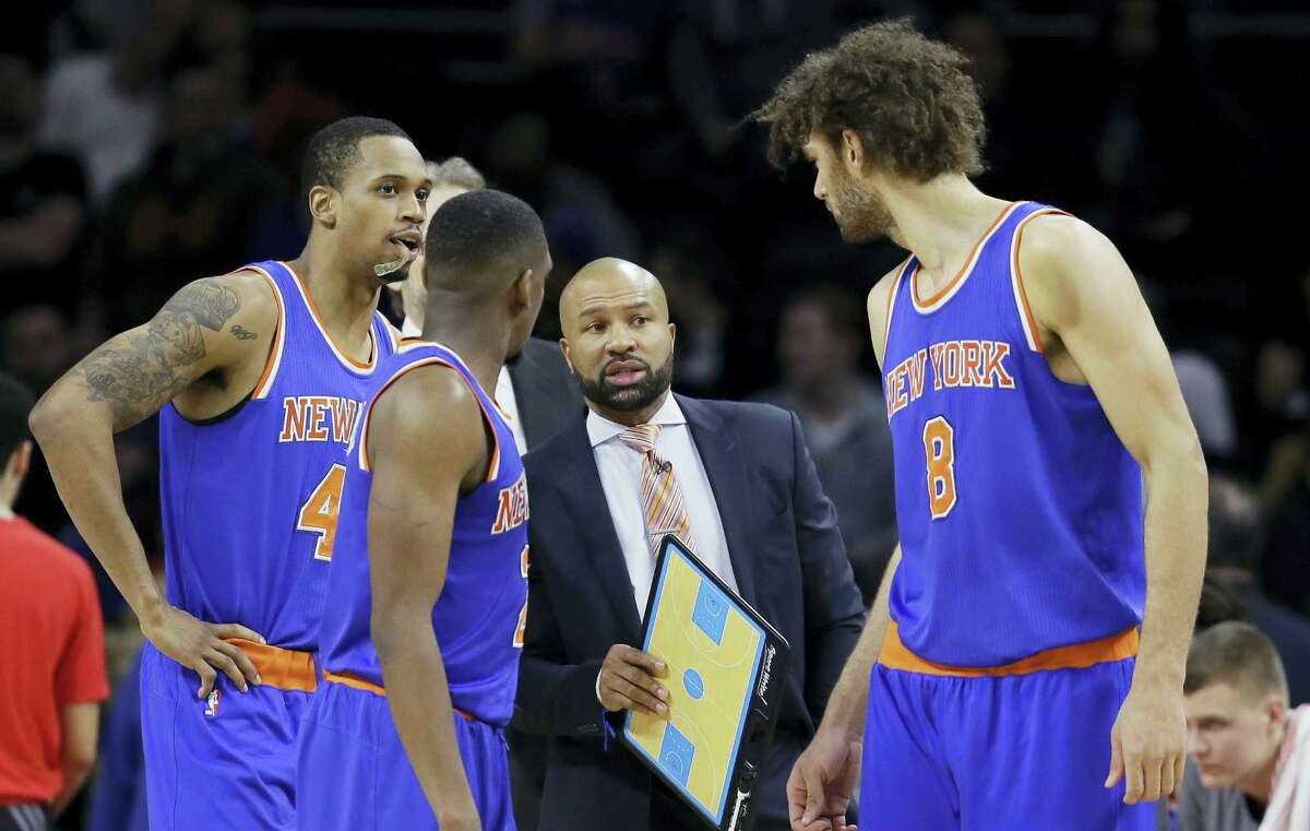 FILE - In this Thursday, Feb. 4, 2016, file photo, New York Knicks head coach Derek Fisher talks to his team during the first half of an NBA basketball game against the Detroit Pistons, in Auburn Hills, Mich. Fisher was fired as New York Knicks coach Monday, Feb. 8, 2016, with his team having lost five straight and nine of 10 to fall well back in the Eastern Conference playoff race. (AP Photo/Carlos Osorio, File)