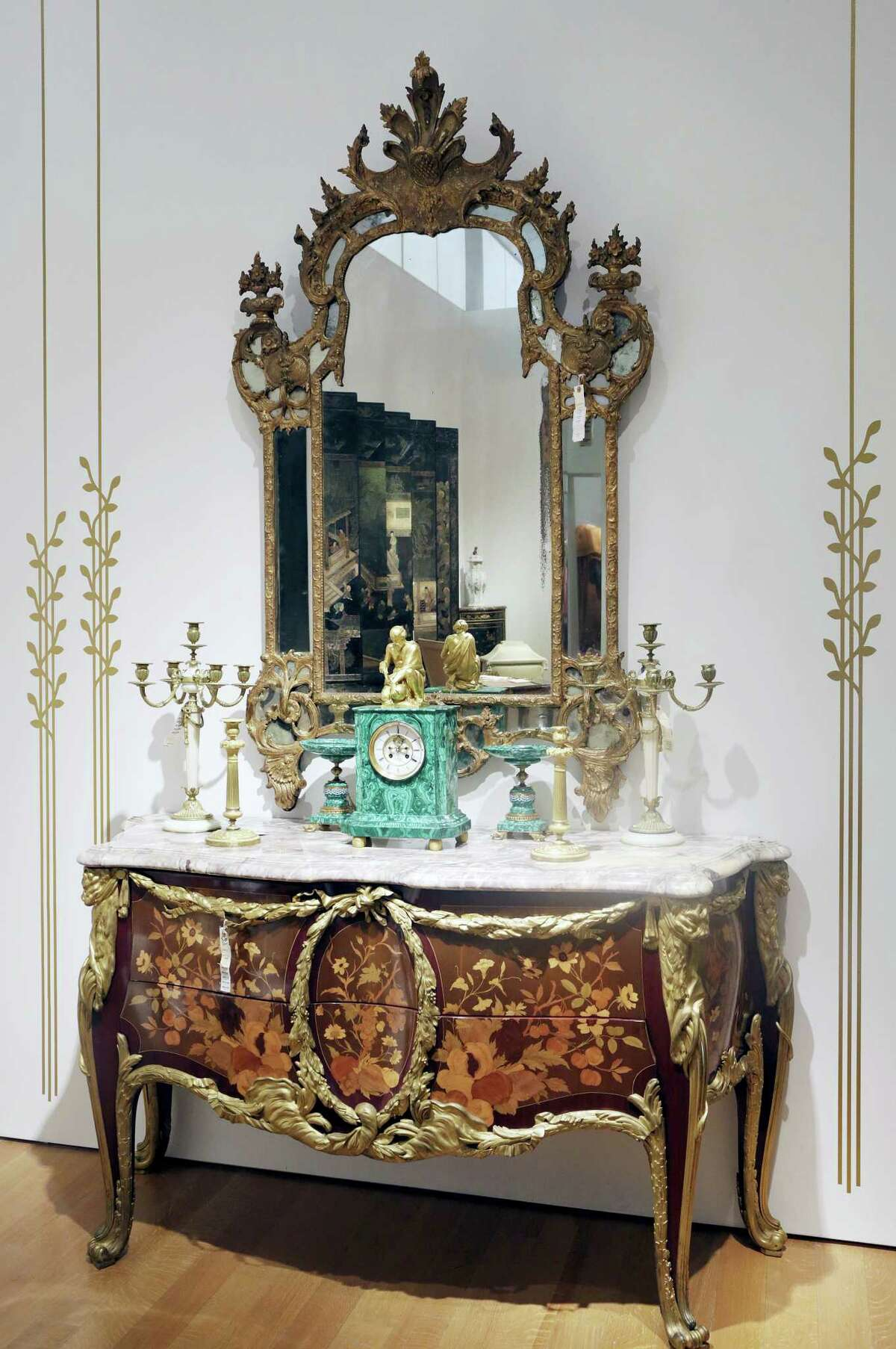 A French chest of drawers, owned by the late comedian Joan Rivers, is displayed at Christie's, Friday, June 17, 2016, in New York. The Private Collection of Joan Rivers has more than 200 lots to be auctioned in a live sale at Christie's on June 22 and about 80 more offered online at Christies.com, starting Thursday through June 23.