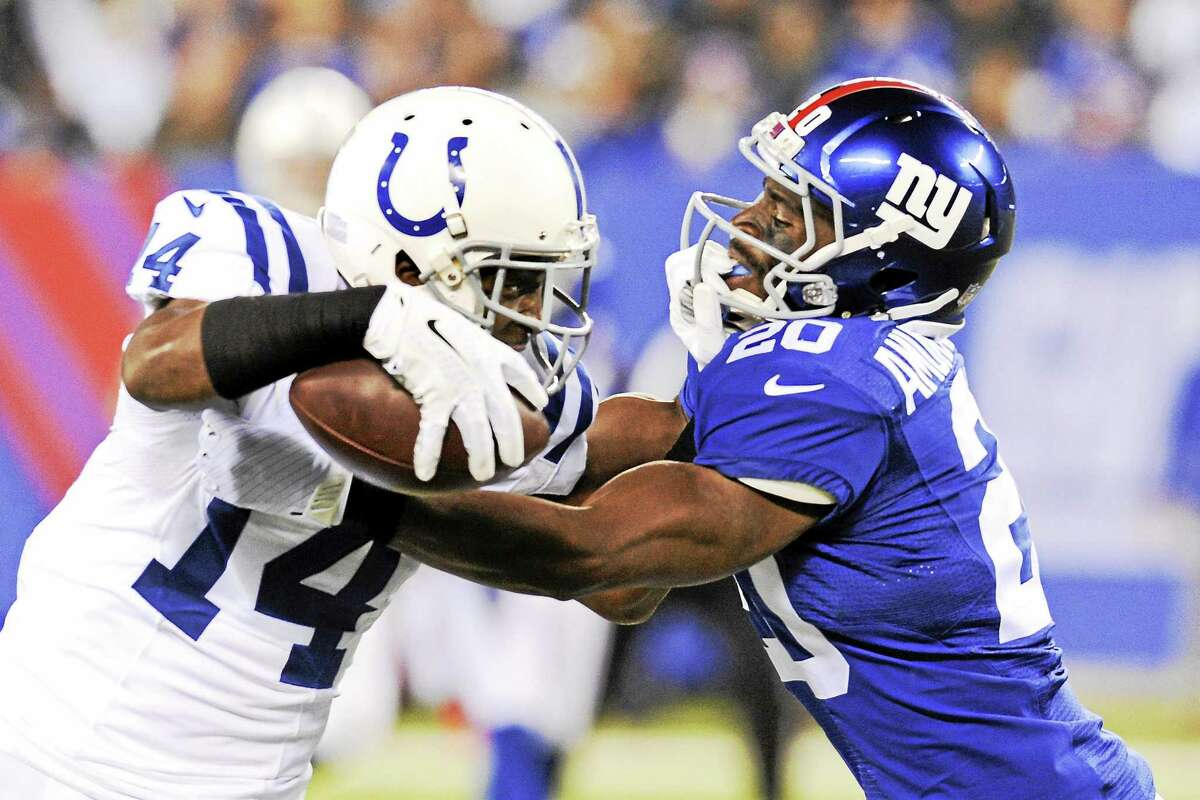 New York Giants cornerback Prince Amukamara tackles Indianapolis Colts receiver Hakeem Nicks during a Nov. 3, 2014, game in East Rutherford, N.J.