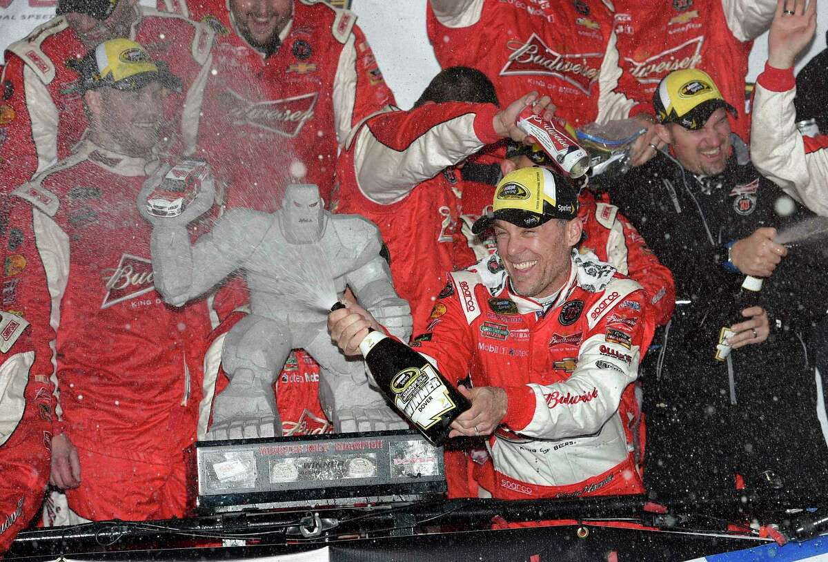 Kevin Harvick celebrates in Victory Lane after he winning at Dover International Speedway on Sunday.