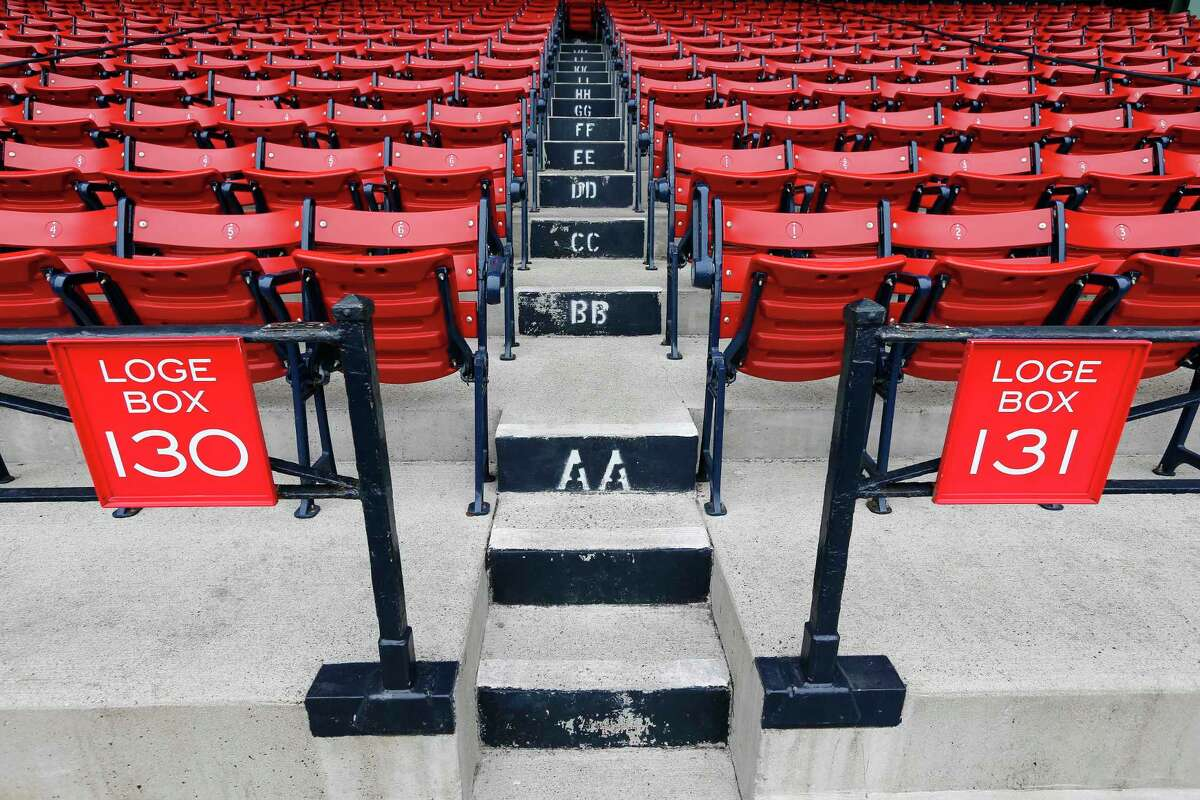 Empty seats are seen at Fenway Park in Boston on Monday.