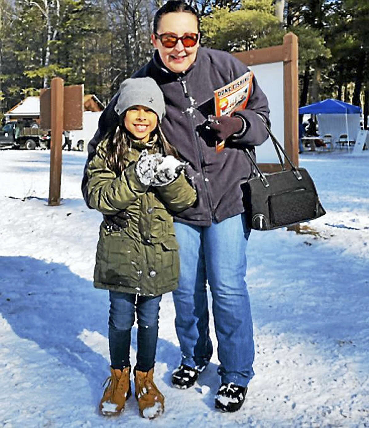 Aliana Abreu, 8, and her grandmother Maria Abreu, of Torrington, attended the 10th annual No Child Left Inside Winter Festival on Saturday at Burr Pond State Park. About 400 people turned out to participate in outdoor activities.