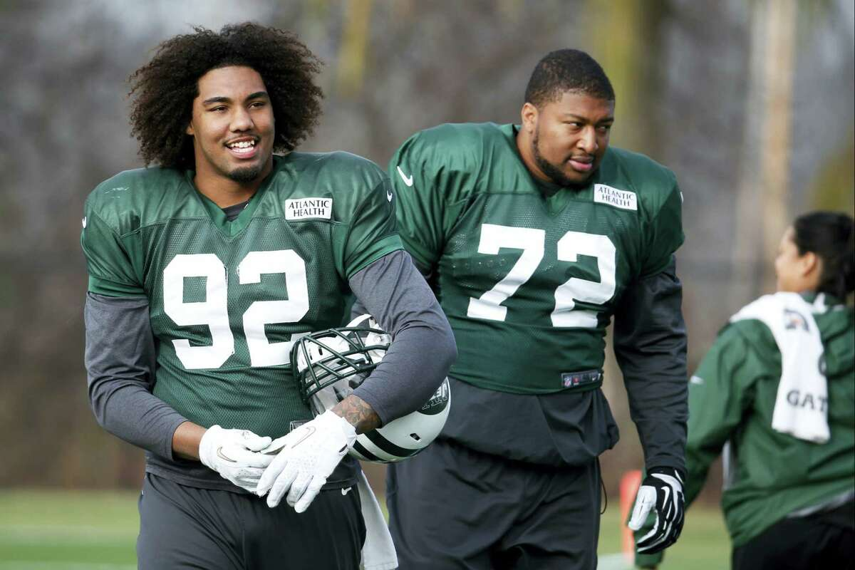 New York Jets defensive end Leonard Williams (92) and defensive end Stephen Bowen look on during a recent practice.