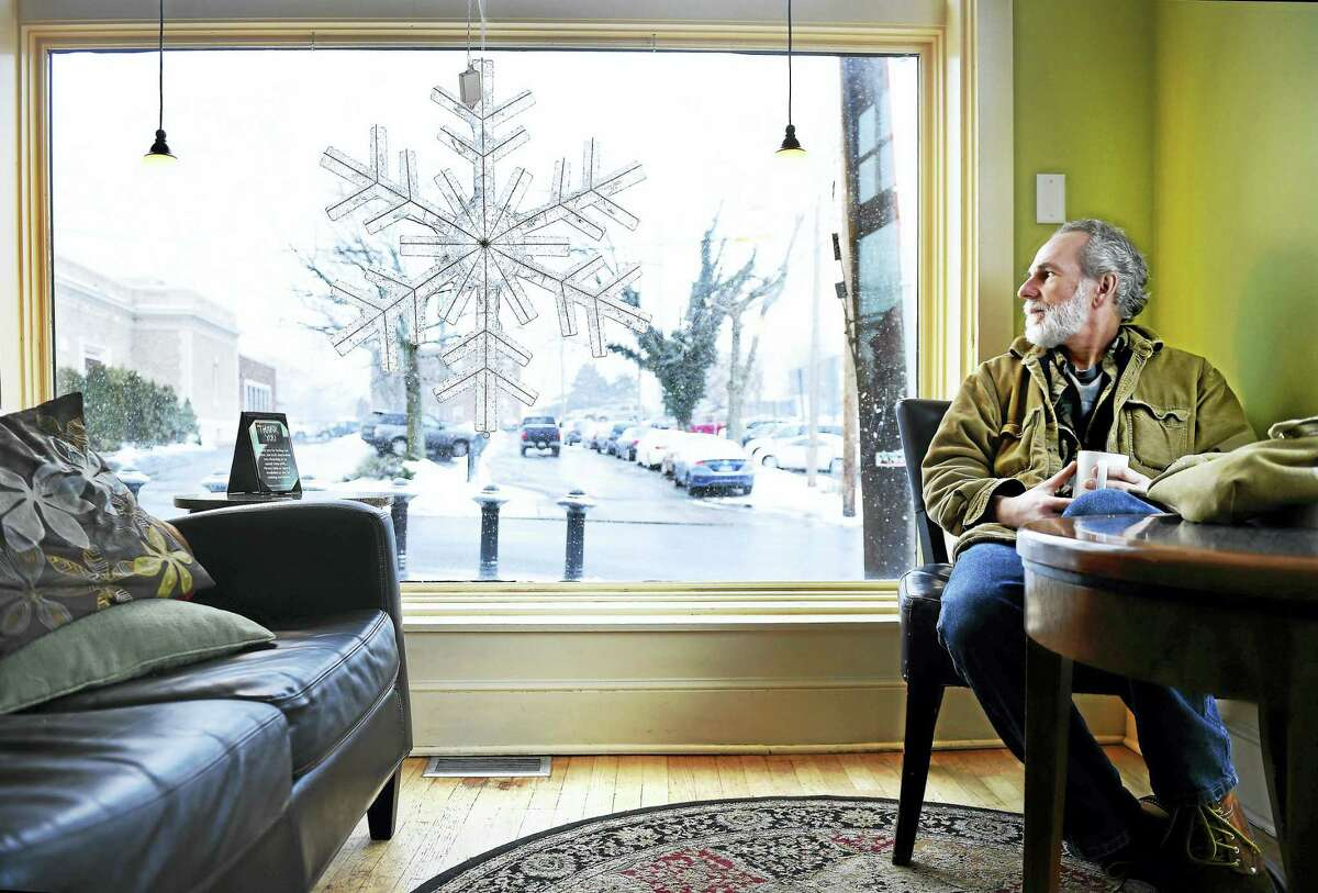 Arnold Gold — New Haven Register Mark McNeiece of Milford watches the weather from inside Cafe Atlantique in Milford on Monday morning 2/8/2016.