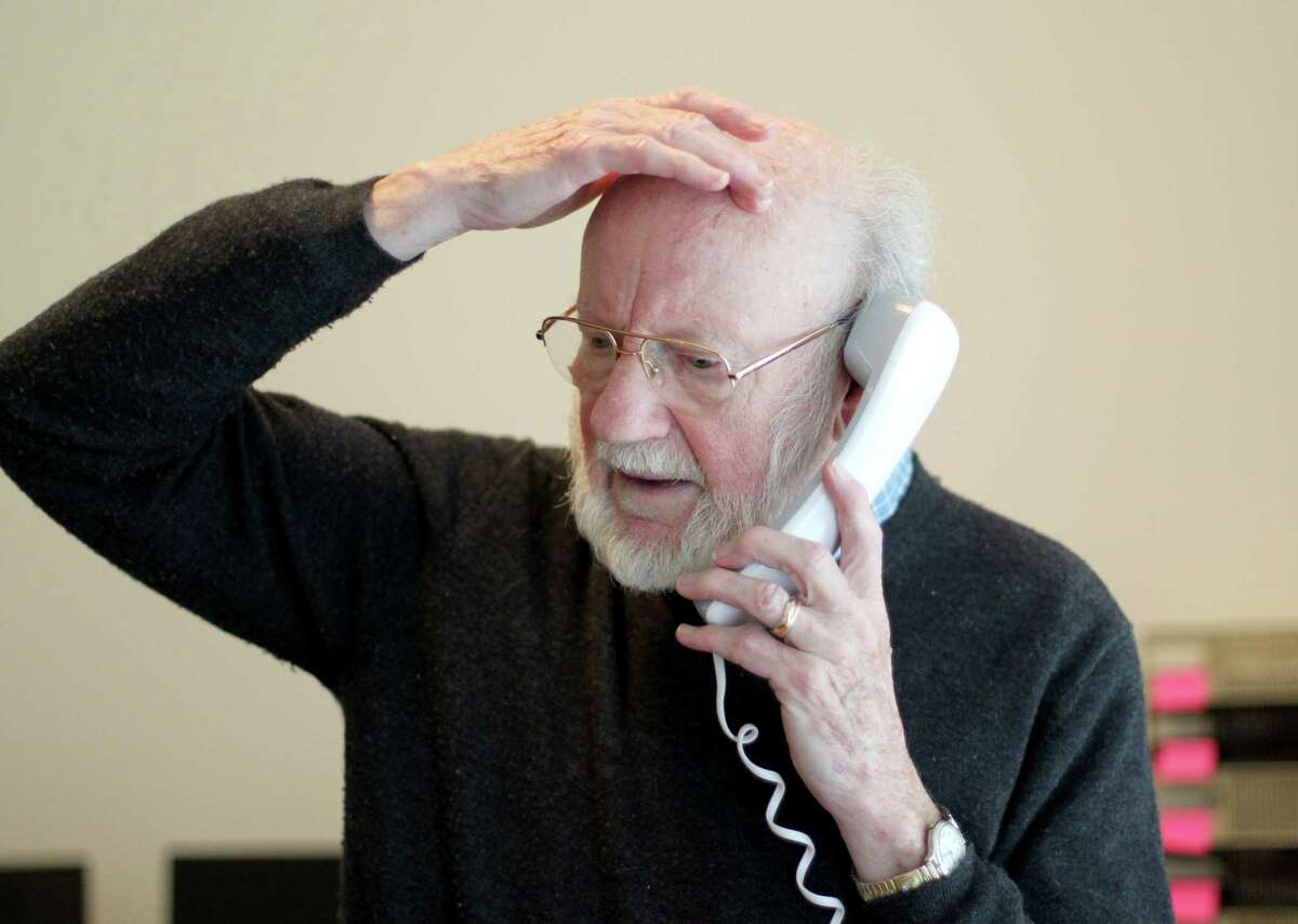Scientist William C. Campbell talks on the phone at his home in North Andover, Mass. on Oct. 5, 2015.