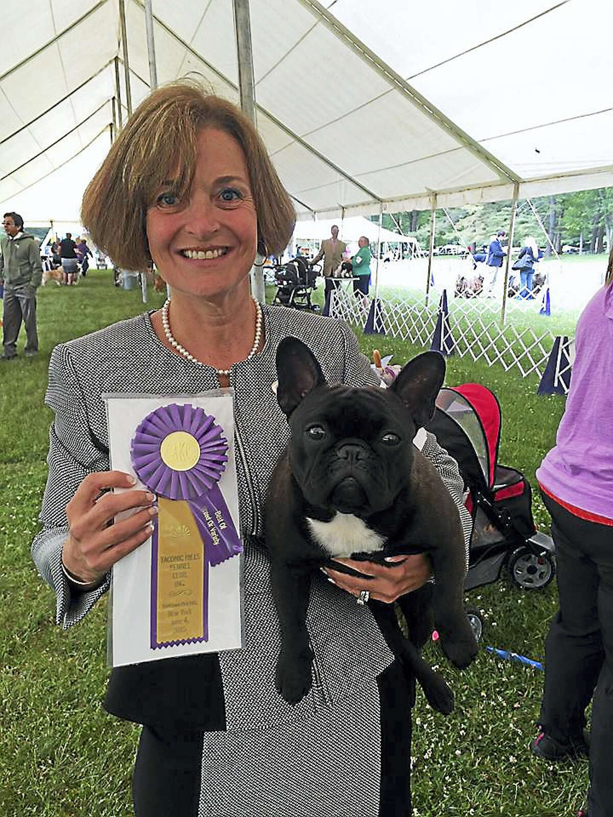 """Ann Egan with 2-year-old French Bulldog Grand Champion Jafrak Persuade Me Not, also known as """"Hazel,"""" will compete in the 140th annual Westminster Kennel Club All Breed Dog Show next week in New York City."""