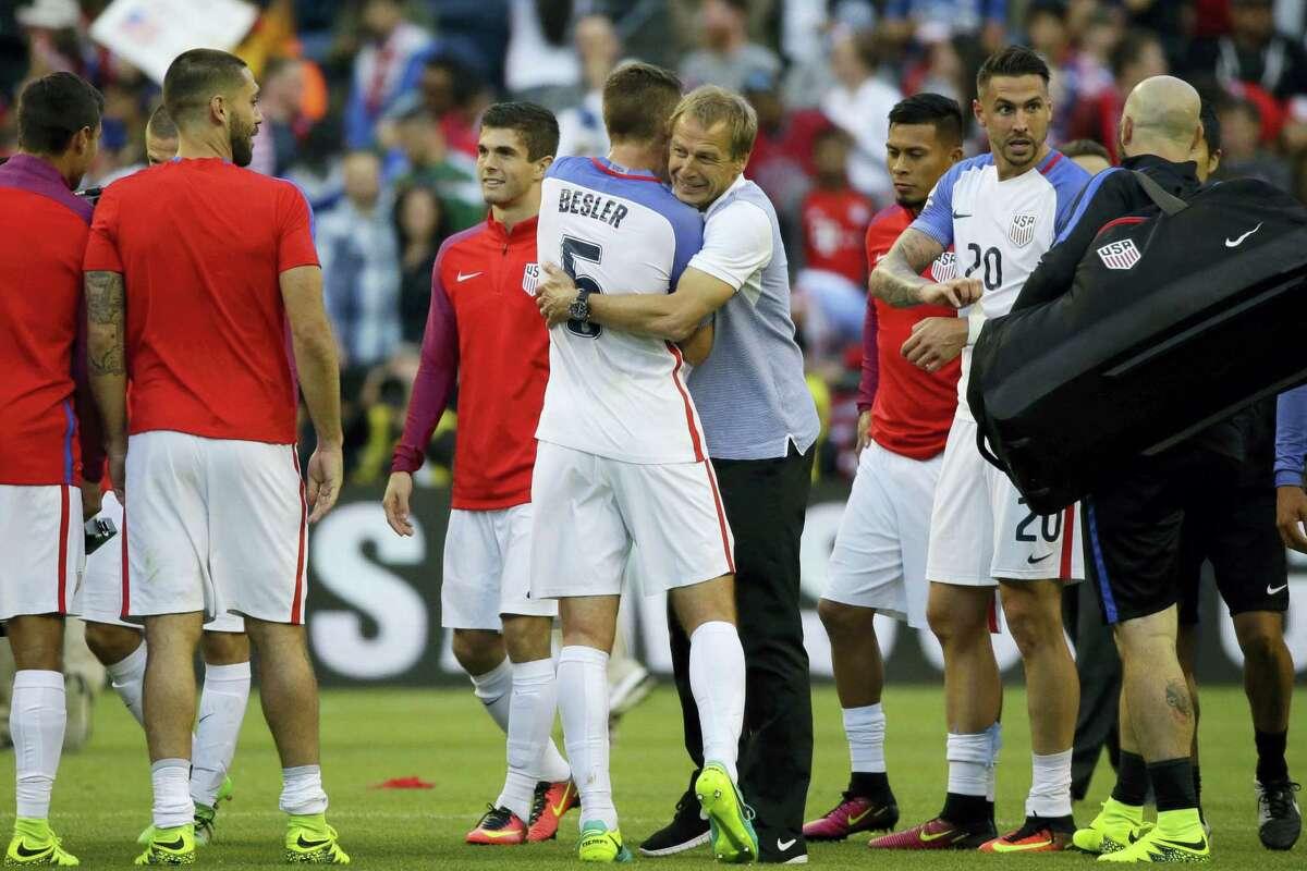 United States coach Jurgen Klinsmann, center. embraces Matt Besler at the end Thursday's win over Ecuador in the Copa America quarterfinals.