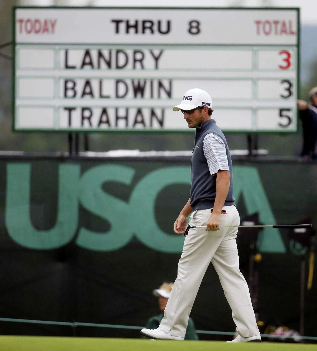 Andrew Landry lines up his putt on the ninth hole on Friday.