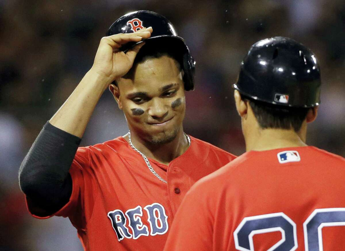 Xander Bogaerts takes his helmet off after popping out to end the seventh inning on Friday.