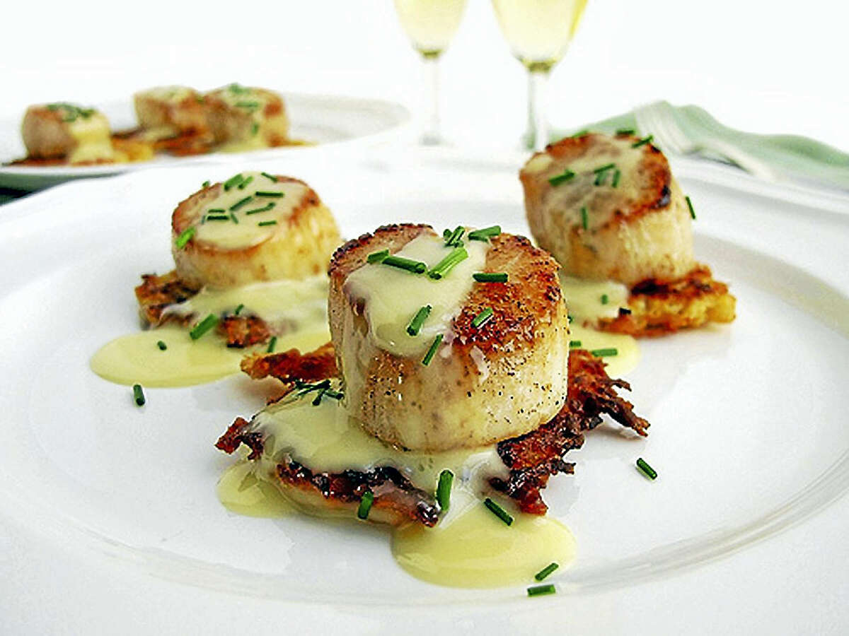 A delicious sauce and a special side can elevate a plate of scallops to new heights.