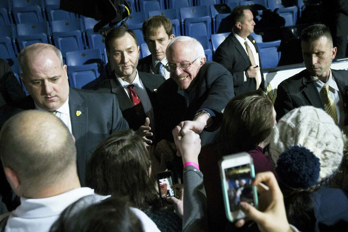ASSOCIATED PRESS Democratic presidential candidate Sen. Bernie Sanders, I-Vt., shakes hands with attendees during a campaign stop at the University of New Hampshire Whittemore Center Arena, Monday in Durham, N.H.