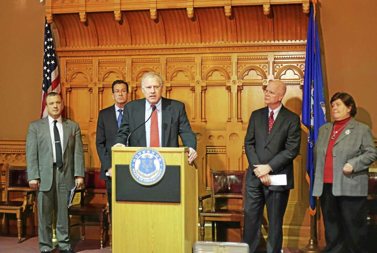 Attorney General George Jepsen speaks at a Capitol press conference flanked at left by Consumer Protection Commissioner Jonathan Harris, Gov. Dannel P. Malloy, and state Comptroller Kevin Lembo. DAS Commissioner Melody Currey is at right