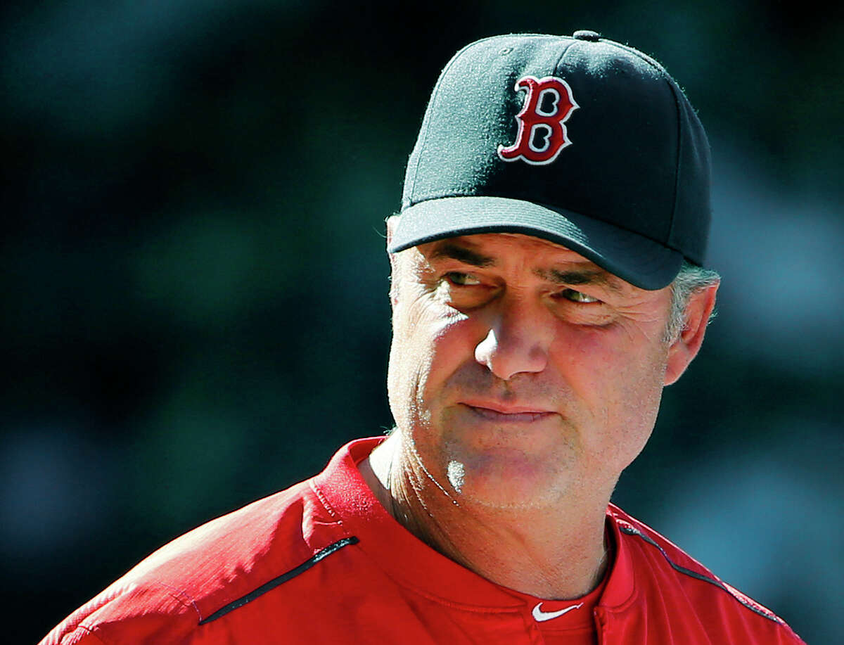 In this Aug. 2, 2015 photo, Boston Red Sox manager John Farrell watches action during the eighth inning of a baseball game against the Tampa Bay Rays at Fenway Park in Boston.
