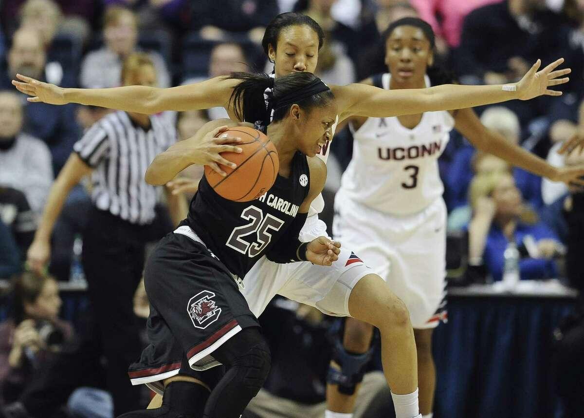 South Carolinaís Tiffany Mitchell, front drives around Connecticutís Saniya Chong, back, during the first half of an NCAA college basketball game, Monday, Feb. 9, 2015, in Storrs, Conn. UConn won 87-62. (AP Photo/Jessica Hill)