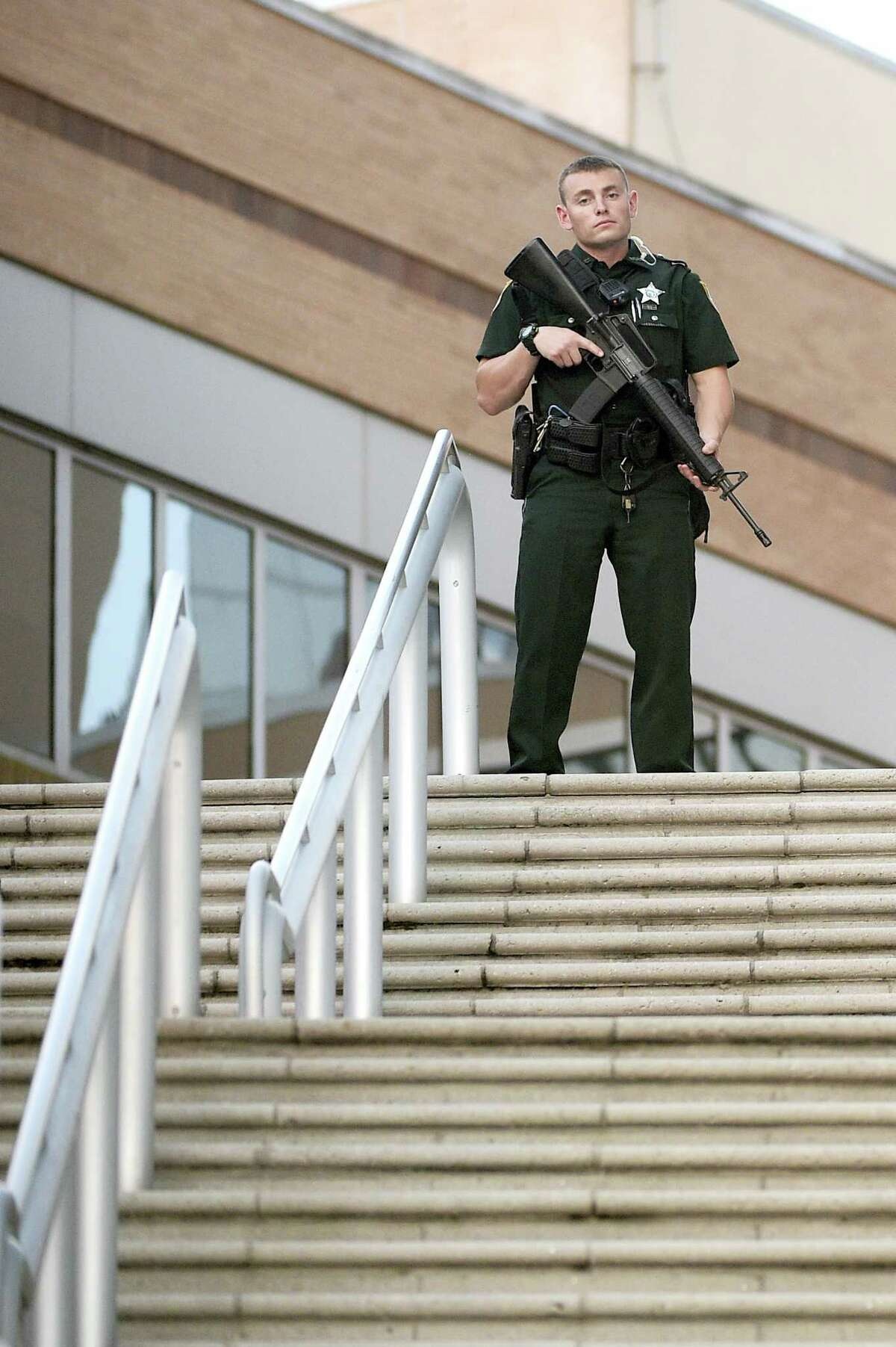 A police officer stands guard outside the Orlando Regional Medical Center hospital after the Pulse nightclub shootings in Orlando, Fla., earlier this week.