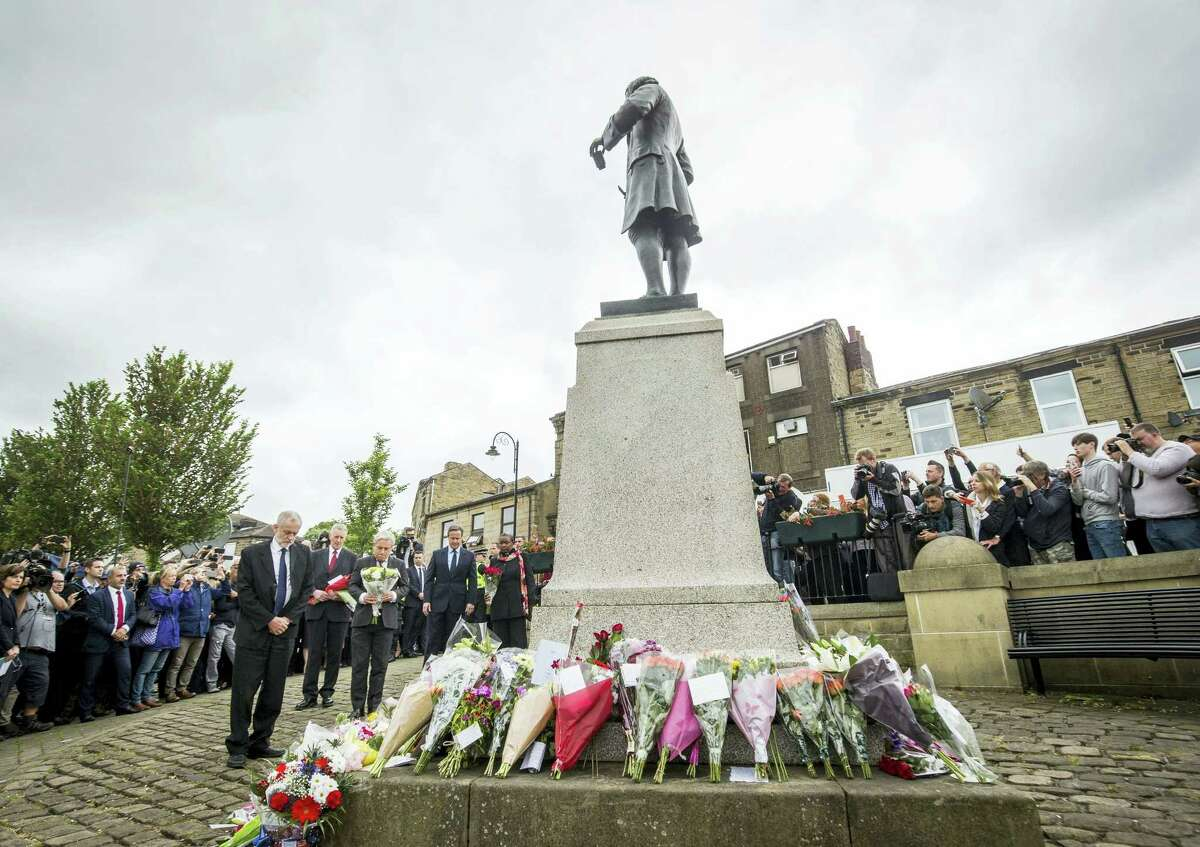 Labour Party leader Jeremy Corbyn, Hilary Benn MP, Commons Speaker John Bercow and Prime Minister David Cameron, from left, lay floral tributes in Birstall, northern England, for Jo Cox, the 41-year-old British Member of Parliament shot to death in northern England, Friday June 17, 2016. The mother of two young children was shot to death Thursday afternoon in her constituency near Leeds. A 52-year-old man has been arrested but has not been charged.