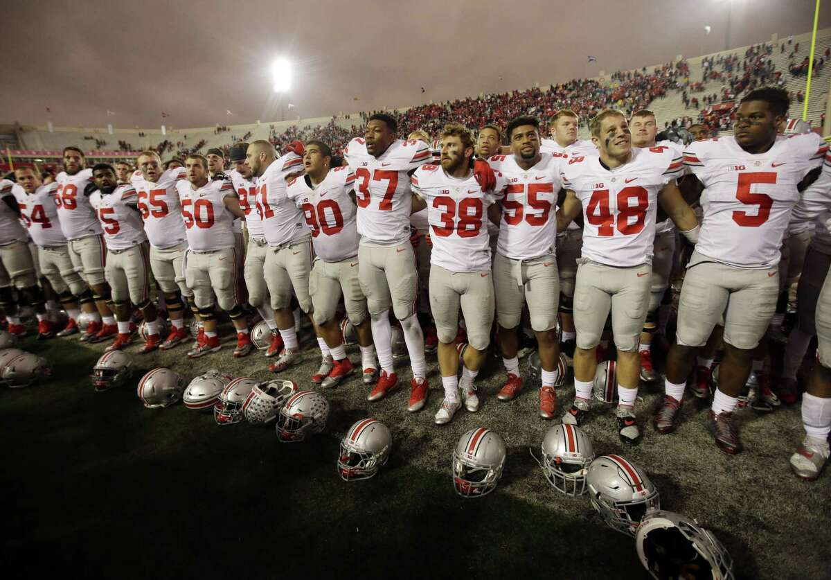 """Ohio State players sing """"Carmen Ohio"""" after defeating Indiana on Saturday."""