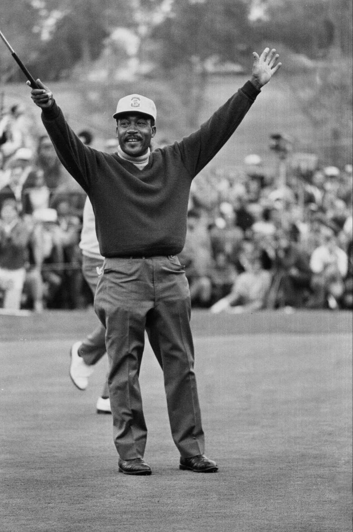 In this Jan. 13, 1969 file photo, Charlie Sifford throws up his arms after he dropped a short par putt on the 18th green to tie Harold Henning at the end of 72 holes in the Los Angeles Open.