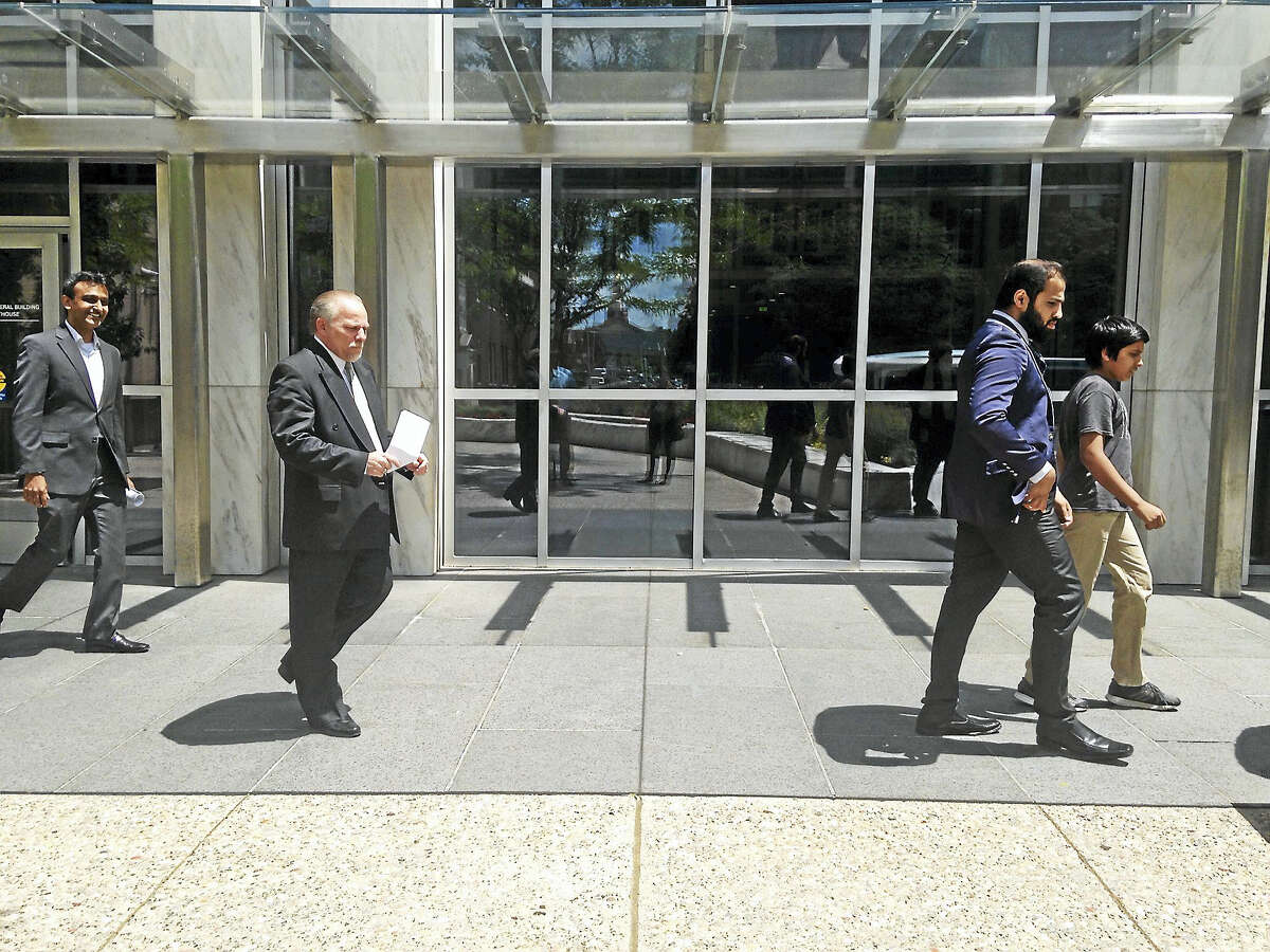 Jeffrey Cohen, the defense attorney representing Ted Hakey Jr., leaves the federal courthouse Friday.