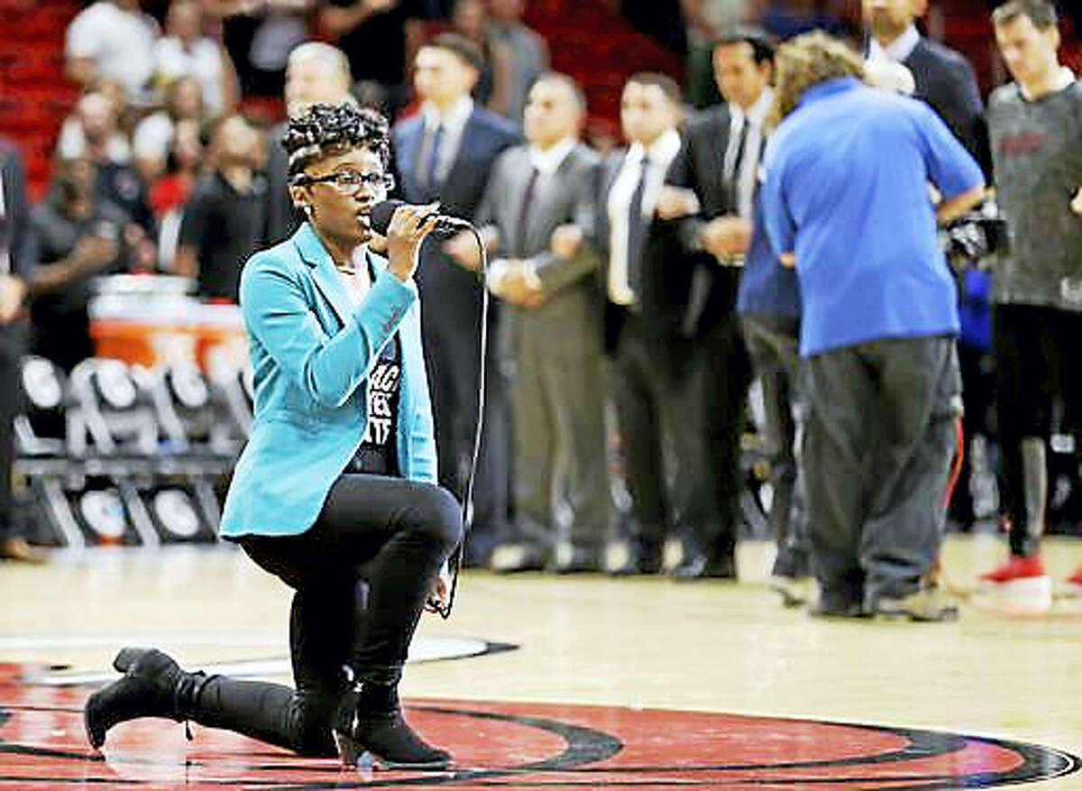 Denasia Lawrence sings the national anthem before an NBA preseason basketball game between the Miami Heat and the Philadelphia 76ers, Friday, Oct. 21, 2016, in Miami.