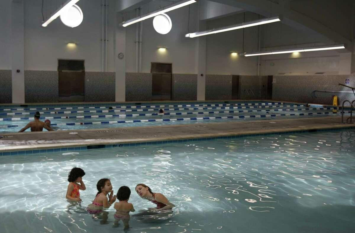 Swim Class at the new Jewish Community Center in San Francisco. The new $83 million Jewish Community Center in San Francisco. You do not have to be Jewish to use the facilities or attend cultural activities there. Russian emigres learning English in a class, and also get the building's executive director, Nate Levine, JCC22-kr196.JPG Event on 2/12/04 in San Francisco. Kurt Rogers/The Chronicle Nate Levine, executive director of the Jewish Community Center, stands in the lobby atrium of the JCCs new $83 million building.