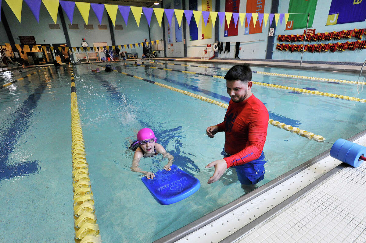 Aquatics director Daniel Servelli gives a on-on-one freestyle swim lesson to Elle Riker at the Jewish Community Center in Stamford, Conn., on Tuesday, April 21, 2015.