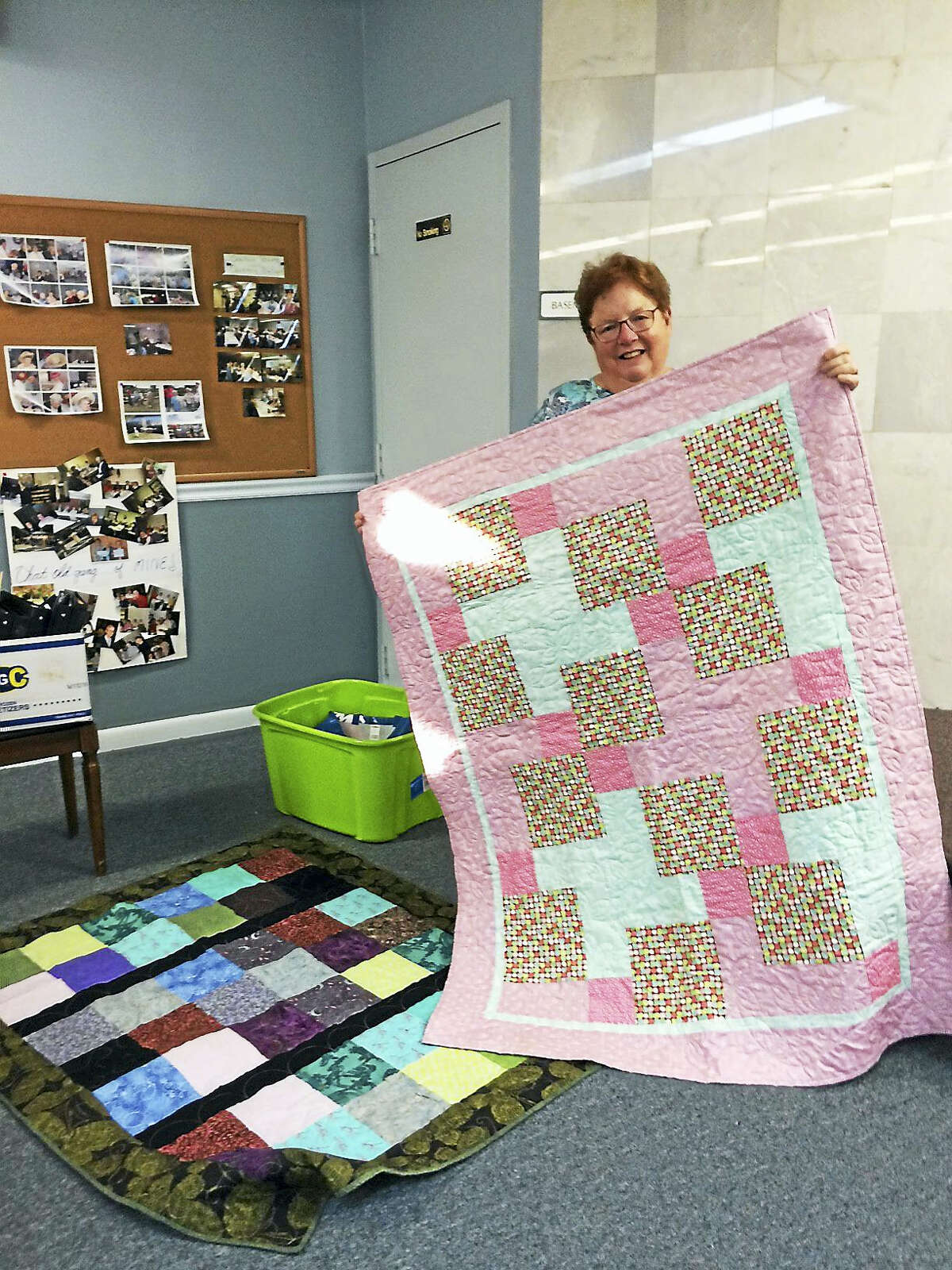 Donna Bruno shows two Parkinson's quilts that she made.