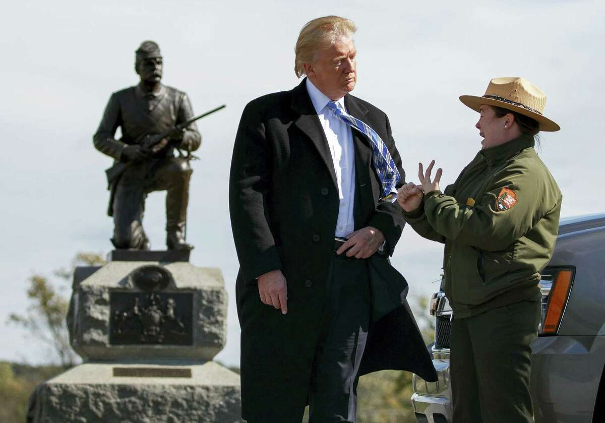 Interpretive park ranger Caitlin Kostic speaks to Republican presidential candidate Donald Trump as she gives him a tour at Gettysburg National Military Park Saturday, Oct. 22, 2016, in Gettysburg, Pa.