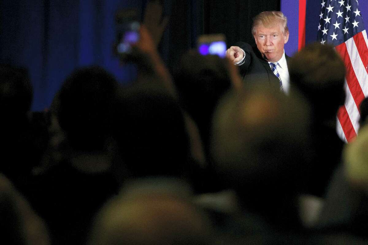 Republican presidential candidate Donald Trump points to the crowd after delivering a speech during a campaign event, Saturday, Oct. 22, 2016, in Gettysburg, Pa.