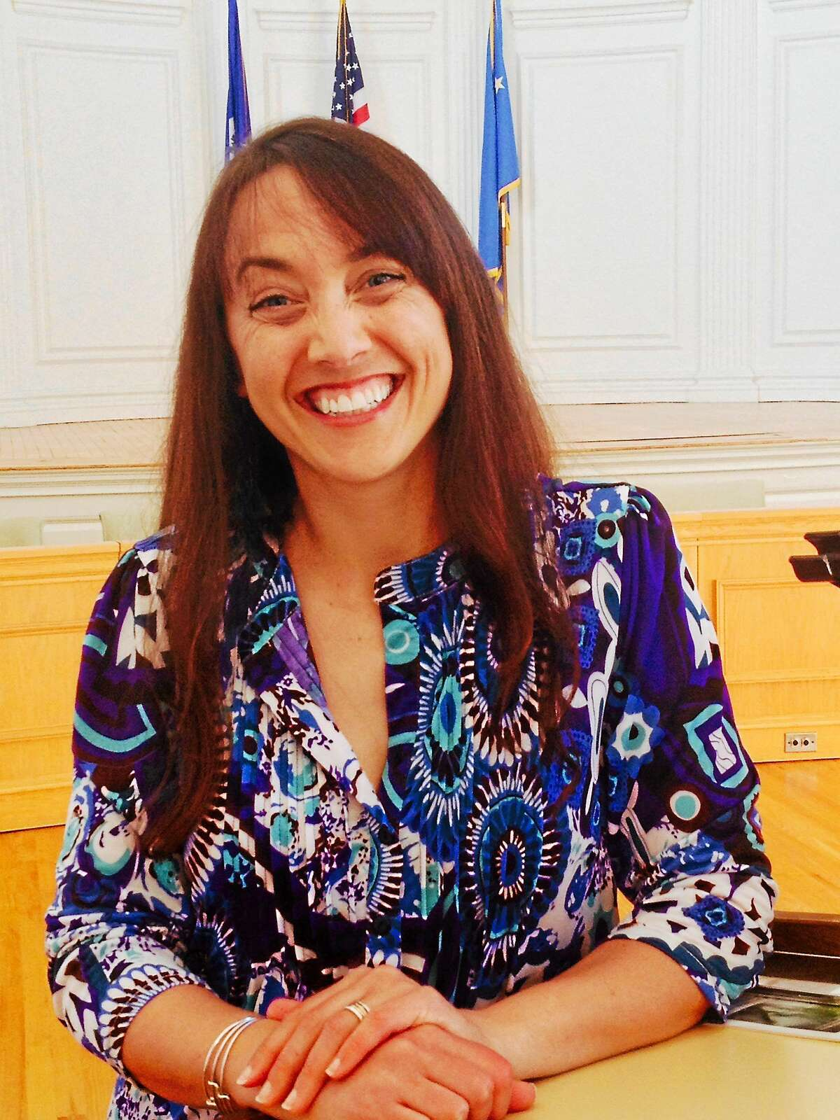 (Pam McLoughlin - New Haven Register) Colleen Kelly Alexander talks in Milford about her road to recovery after being run over by a truck while bicycling.