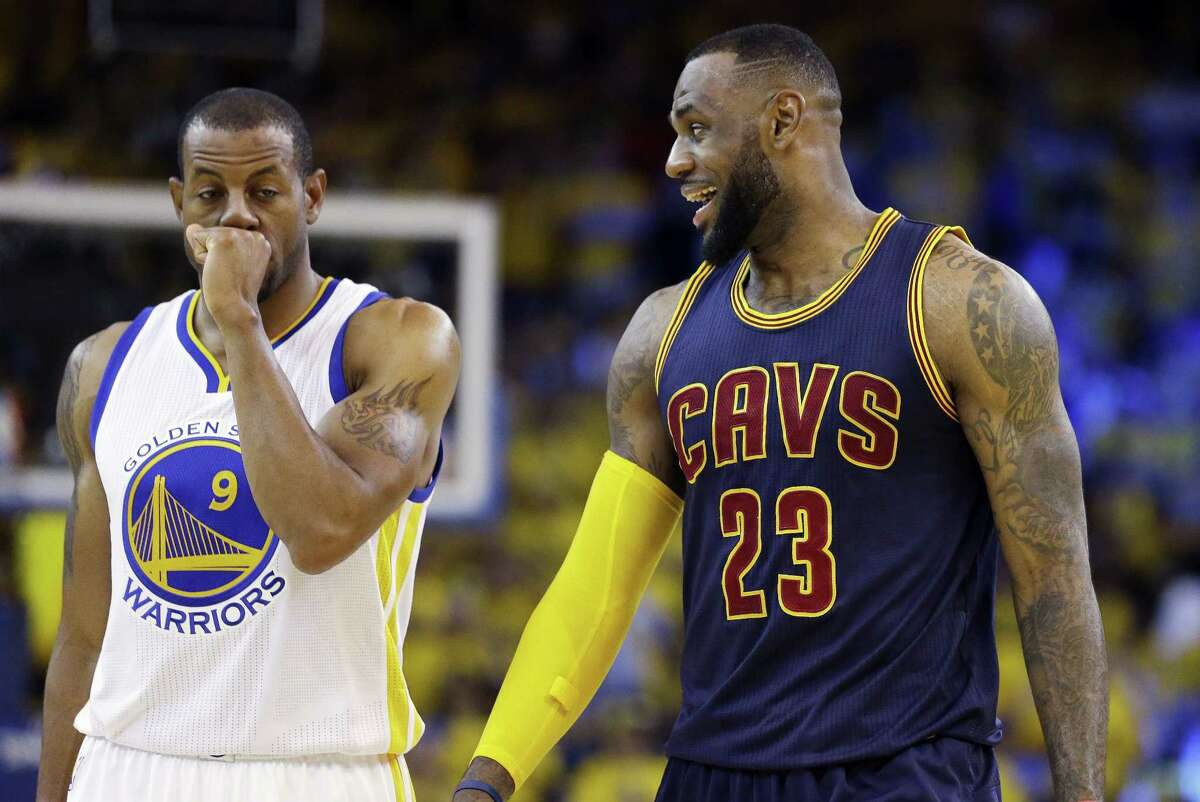Cavaliers forward LeBron James (23) smiles next to Warriors forward Andre Iguodala during the second half of Game 2 of the NBA Finals on Sunday.