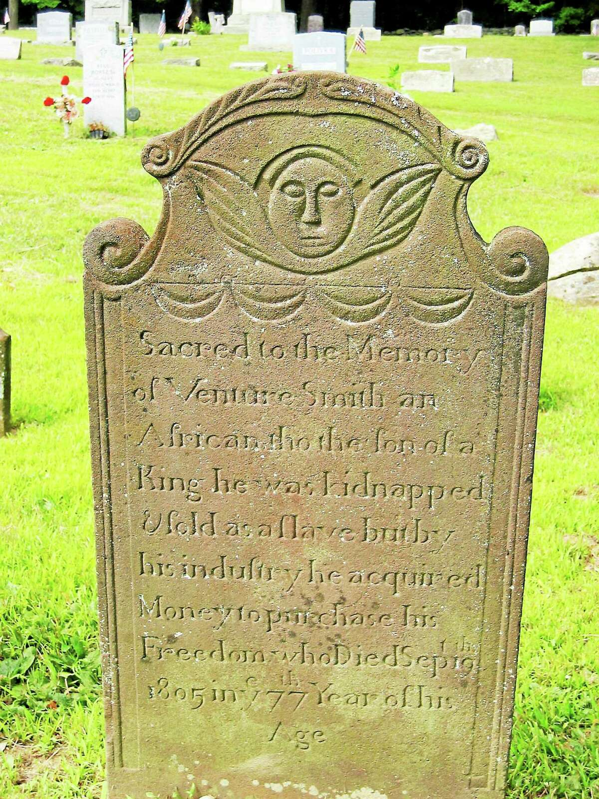 The tombstone of Venture Smith is seen in the cemetery of the First Church of East Haddam. Smith was a former slave who bought freedom for himself and his family and built a thriving shipping business on the Connecticut River and owned a 100-acre farm on Haddam Neck.