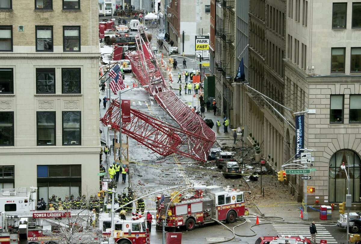 A collapsed crane fills the street on Feb. 5, 2016 in New York. The huge construction crane was being lowered to safety in a snow squall when plummeted onto the street in the Tribeca neighborhood of lower Manhattan.
