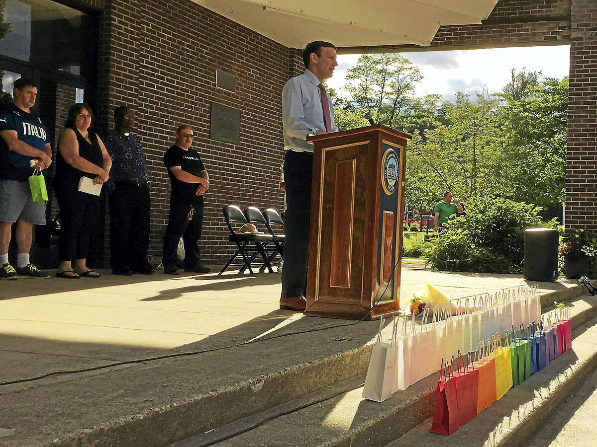 Ben Lambert - The Register CitizenA vigil was held in remembrance of the victims of the recent mass shooting in Orlando, including city native Kimberly Morris, Friday in Torrington.