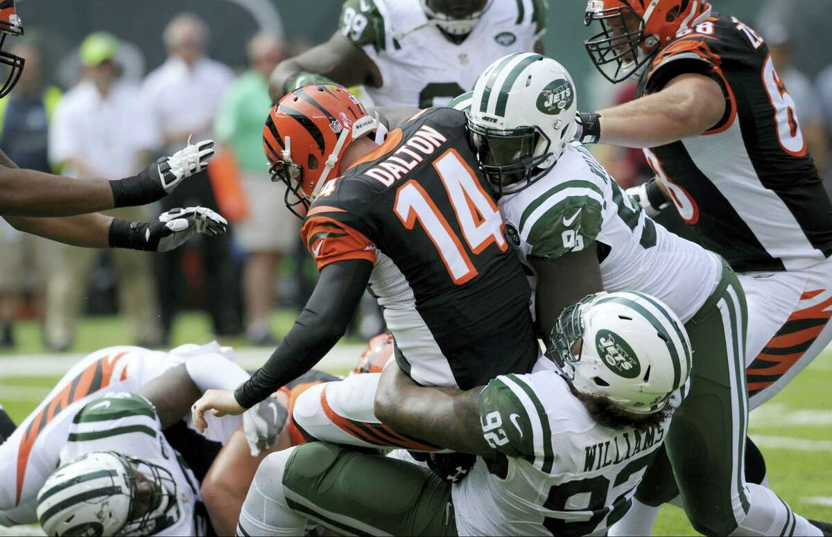Cincinnati Bengals quarterback Andy Dalton (14) is sacked by the Jets' Leonard Williams (92) and Muhammad Wilkerson (96) during a game earlier this season.