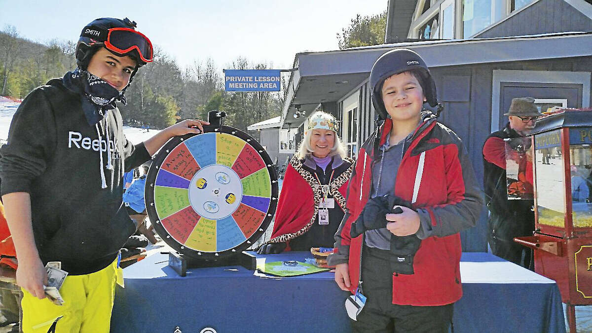 Young skiers B.G., 14, and Jimmy, 11, played a game teaching skiing safety with guest services volunteer Marge Cohen at Winter Carnival at Ski Sundown.