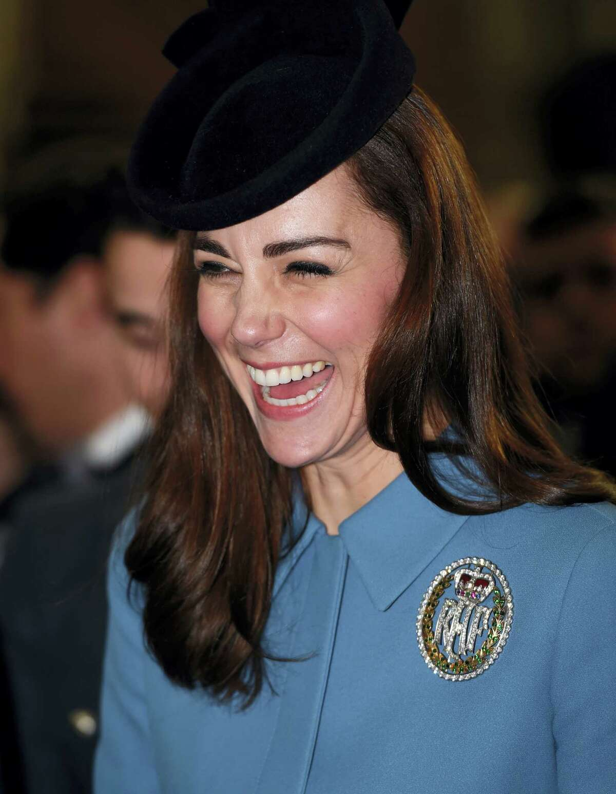 Britain's Kate, the Duchess of Cambridge reacts, as she attends a service to mark the 75th anniversary year of the RAF Air Cadets, in London on Feb. 7, 2016.