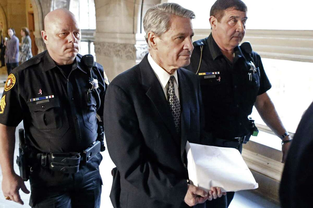 FILE - In this Oct. 23, 2014 file photo, Dr. Robert Ferrante, center, is escorted to court by Allegheny County Sheriff deputies during jury selection for his trial on charges of the 2013 killing of his neurologist wife with cyanide in Pittsburgh. On Wednesday Feb. 4, 2015, Ferrante was sentenced to a mandatory term of life in prison without possibility of parole in the cyanide poisoning death of his wife, Dr. Autumn Klein. (AP Photo/Keith Srakocic, FILE)