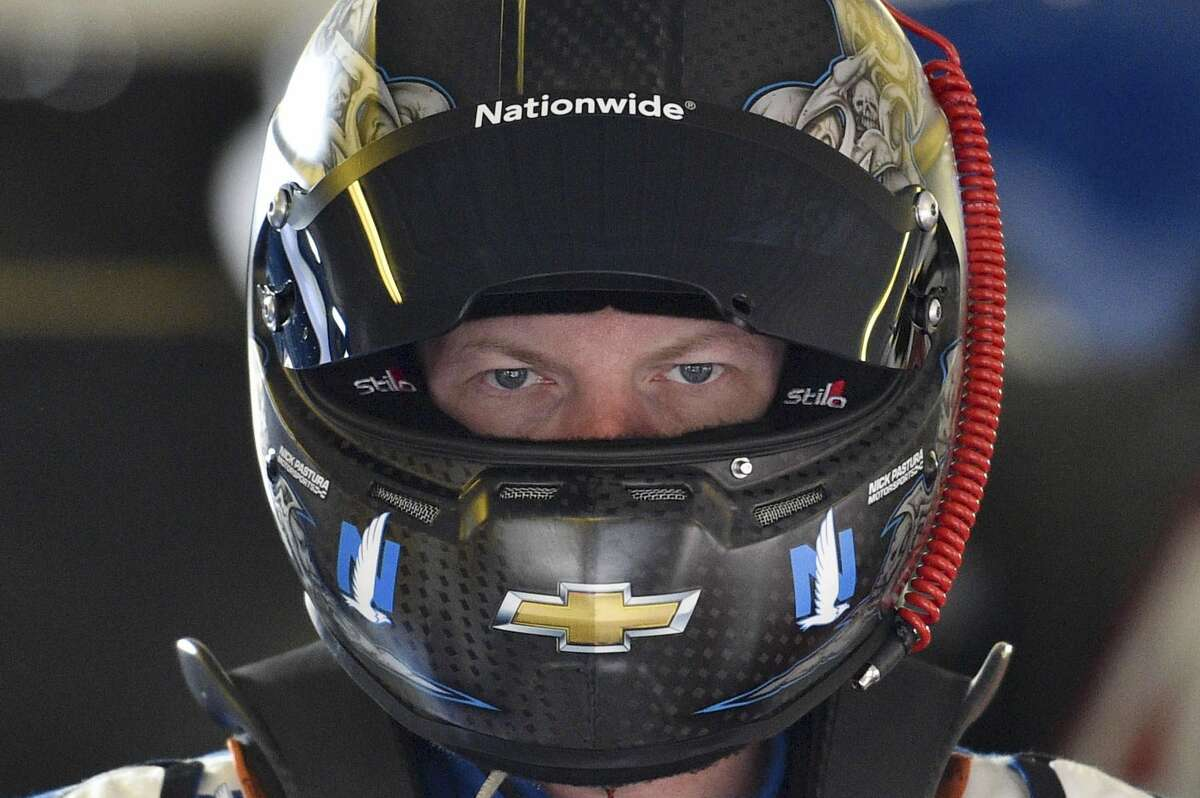 Dale Earnhardt Jr. waits outside his race car Saturday at Pocono Raceway during practice for Sunday's NASCAR Sprint Cup race in Long Pond, Pa.