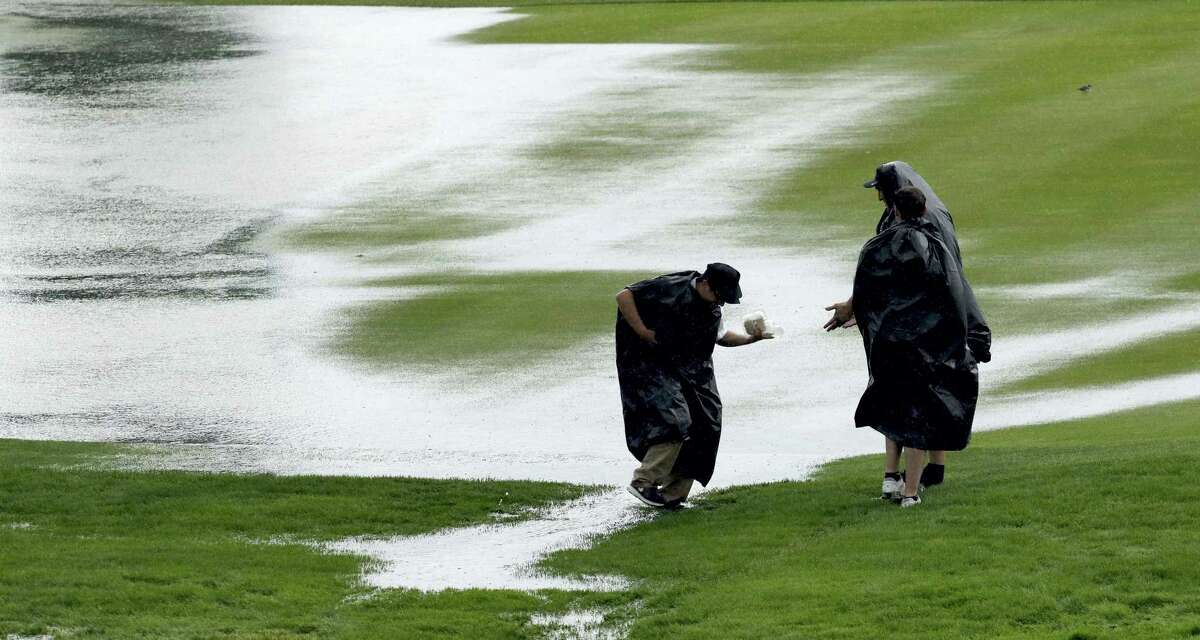 Fans cross the third fairway at the U.S. Open in Oakmont, Pa.