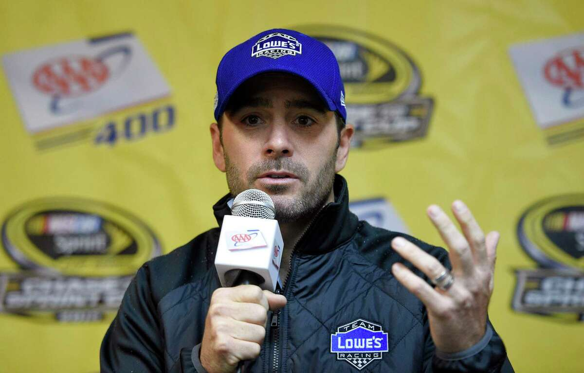 Jimmie Johnson talks to reporters at an interview session on Friday at Dover International Speedway.