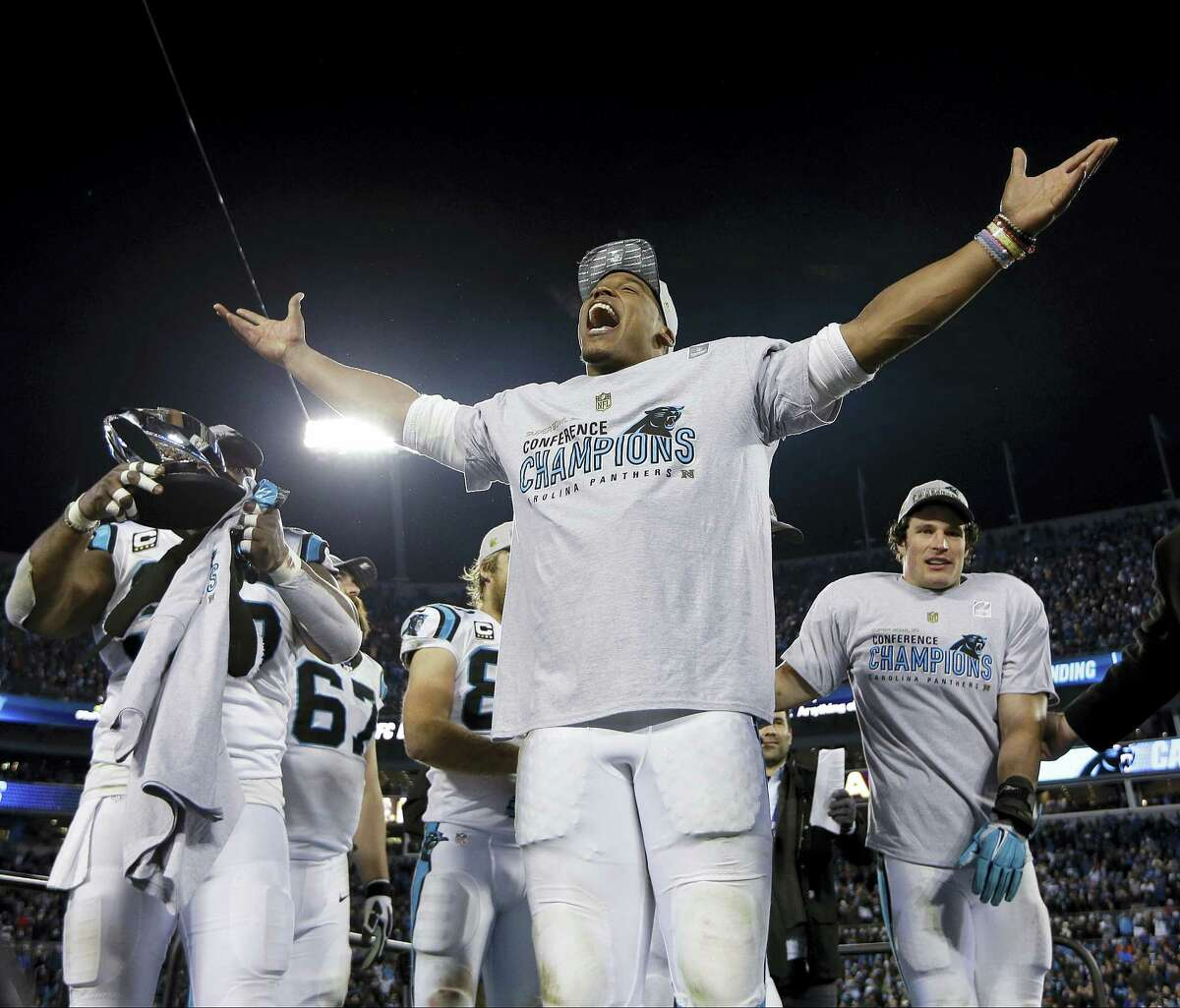 Panthers quarterback Cam Newton celebrates after his team's win in the NFC Championship game. Register columnist Chip Malafronte says if the Panthers win Super Bowl 50, they deserve to be in the conversation as one of the greatest teams in NFL history.