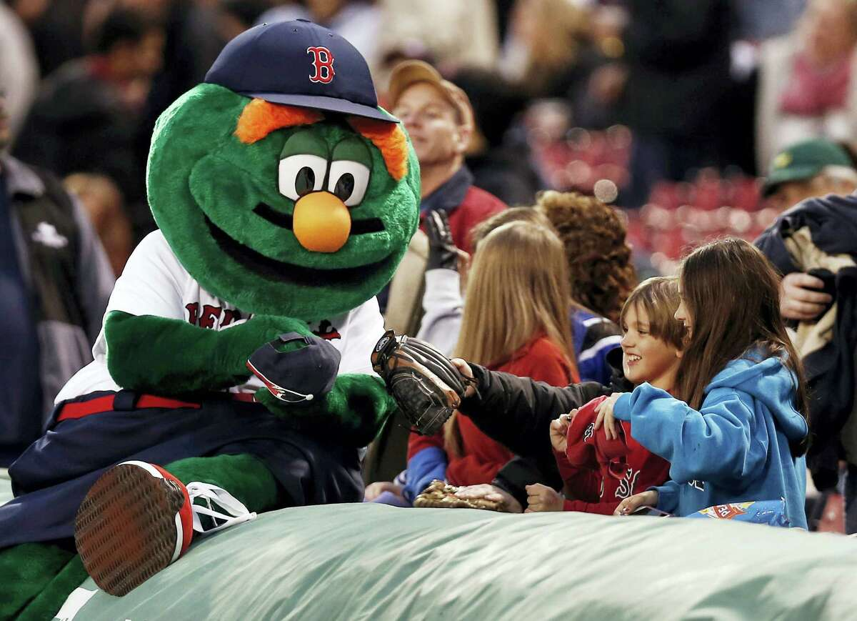 Wally The Green Monster meets with young fans in Boston.