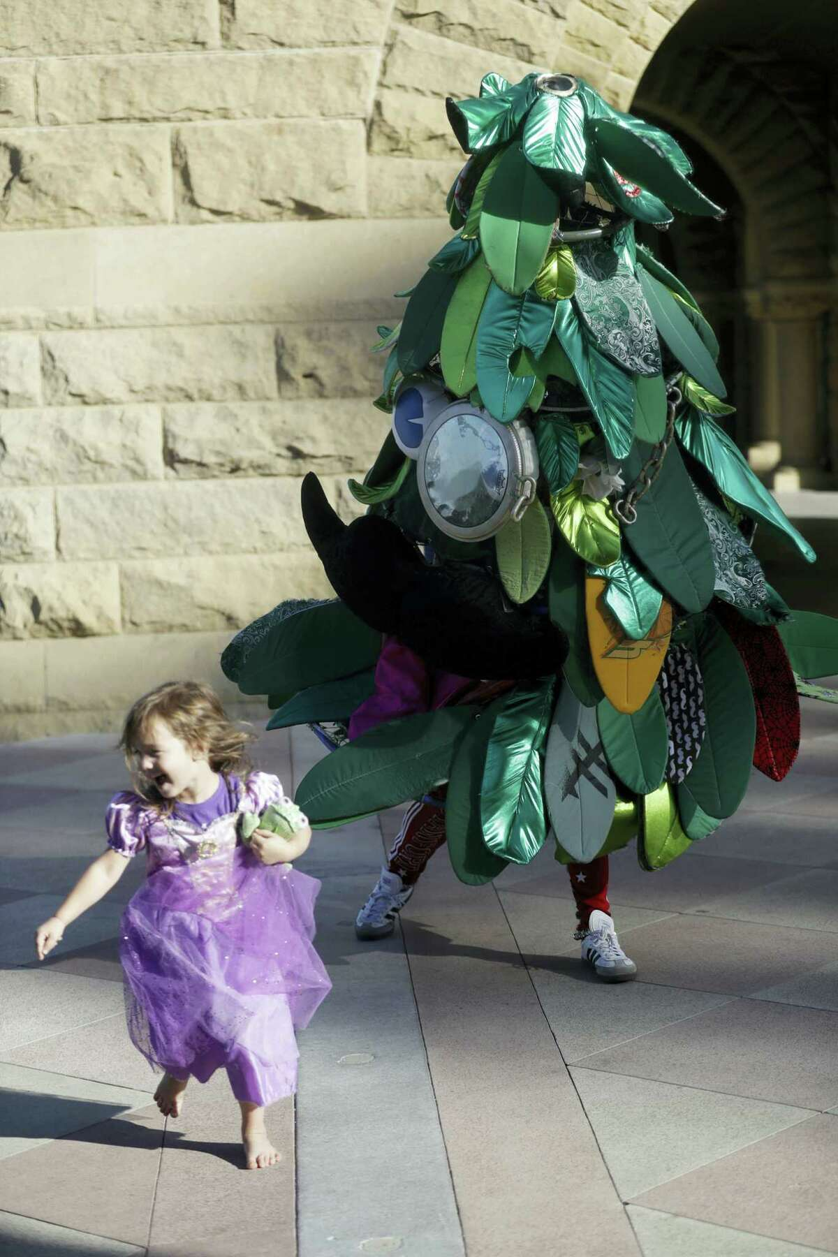Stanford University student Sam Weyen, who portrays the Stanford Tree, the school's mascot, jokes with a young visitor.