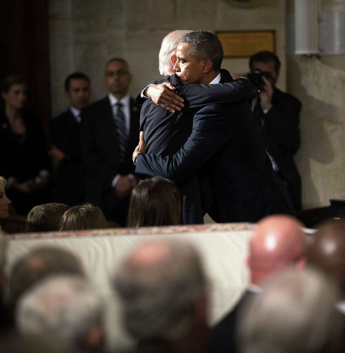 President Obama hugs Vice President Joe Biden during the funeral services for Biden's son, Beau Biden, Saturday, June 6, 2015, at the St. Anthony of Padua Church in Wilmington, Del. (Doug Mills/The New York Times Times via AP, Pool)