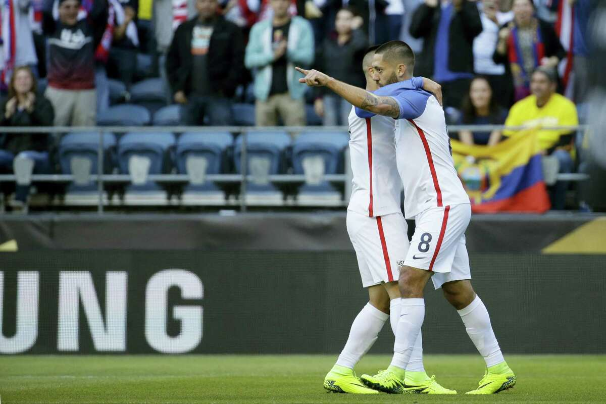 Clint Dempsey, right, celebrates with a teammate after scoring his side's first goal against Ecuador on Thursday.