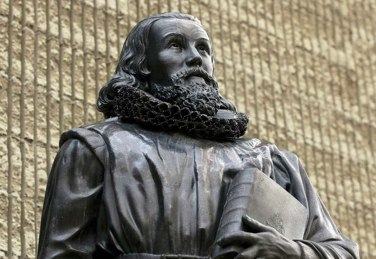 In this Thursday, Oct. 20, 2016, photo a 19th century bronze statue of Puritan John Winthrop, by sculptor Richard Saltonstall Greenough, stands outside the First Church in Boston, in Boston's Back Bay neighborhood. The famously straight-laced 17th-century sectarians who helped settle America weren't nearly as priggish as you might think, says leading Puritan scholar Francis Bremer, who points to a love letter that Winthrop wrote in 1618 to his wife Margaret as an example of Puritan passion.
