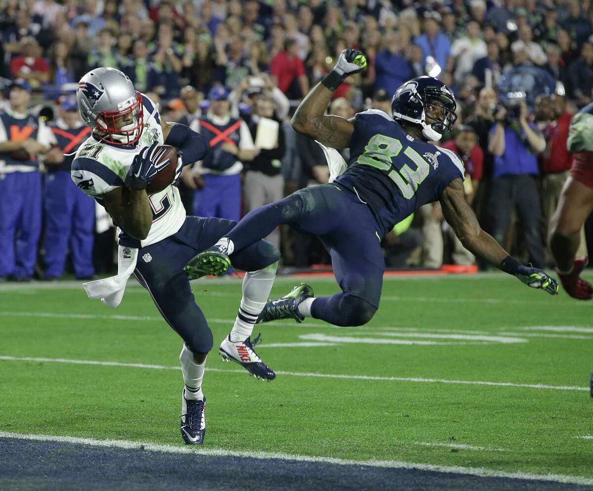 New England Patriots strong safety Malcolm Butler (21) intercepts a pass intended for Seattle Seahawks receiver Ricardo Lockette (83) during the closing minute of Sunday's Super Bowl in Glendale, Ariz.